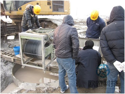 Technician test pile onsite - Qianjiang Project South Wiring Channel DuSense LLC Project