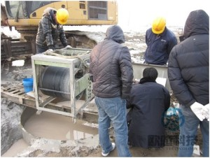 Technician test pile onsite Qianjiang Project South Wiring Channel
